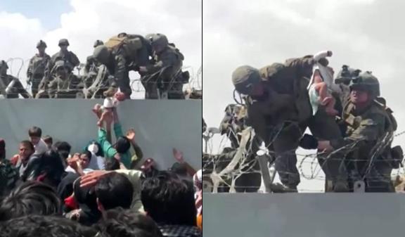 Afegãos passam bebê por arame farpado para soldados americanos